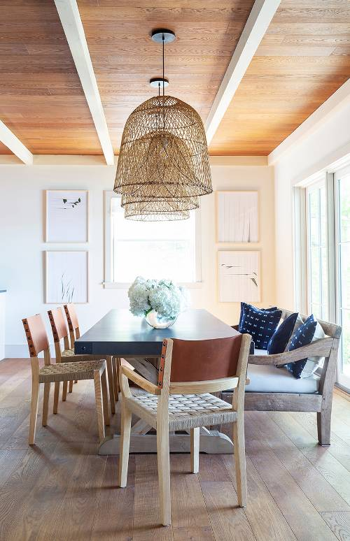 dining banquette leather dining chairs deep blue dining table deep blue throw pillows wood floors pendants with bamboo trap fish lampshades