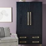 Elegant Armoire Wardrobe In Black Supported With Brass Handles Striped Chair