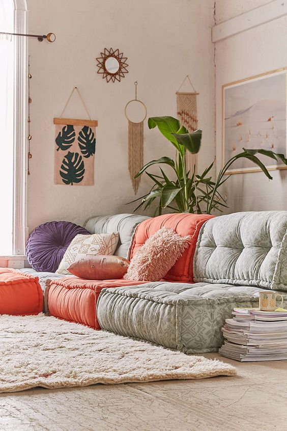 floor cushions in gray and bold orange white shag rug light wood floors Boho wall decors