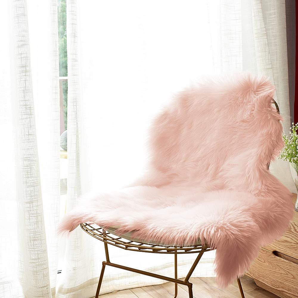fluffy sheepskin chair cover in baby pink wire chair
