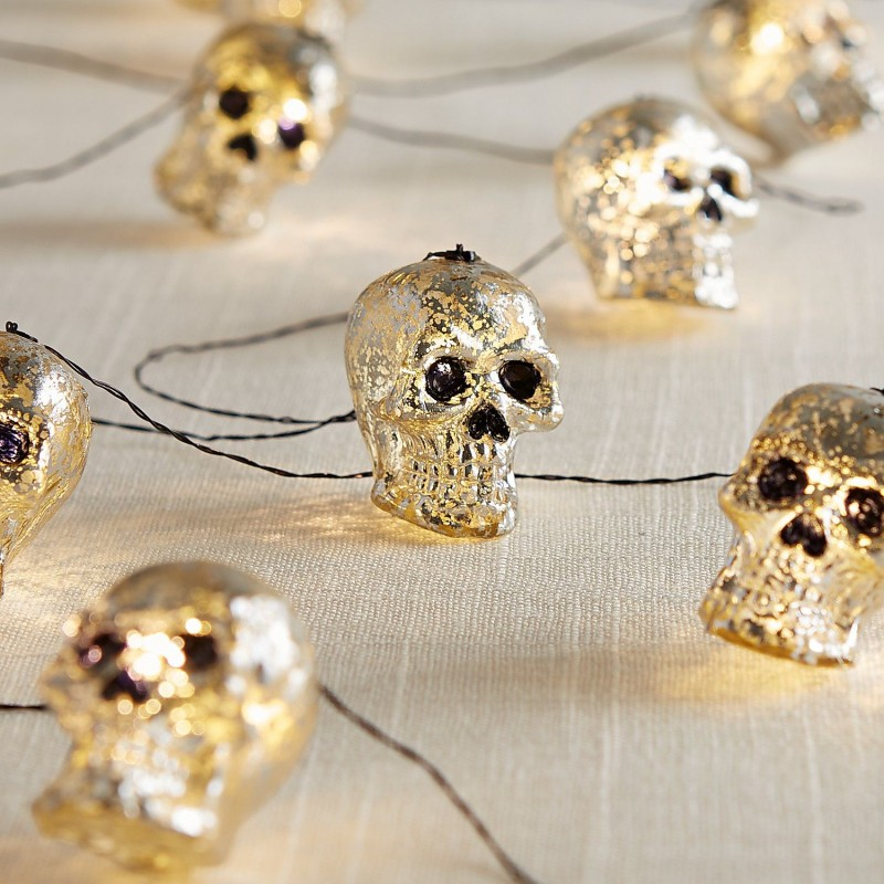 glimmering skulls string lights in silver