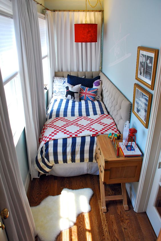 growing teen boy bedroom striped comforter patterned blanket floor to ceiling curtains in white x base wood side table wood floors fur mat in white