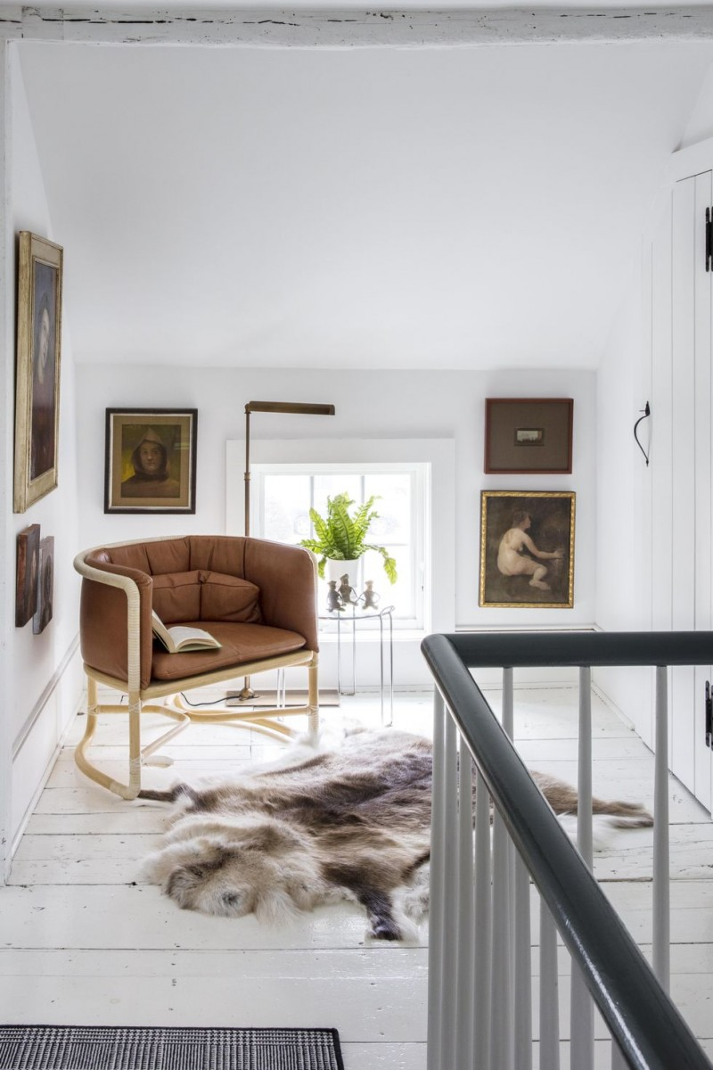 hallway reading corner idea modern arm chair with metal frame fur throw rug modern floor lamp white crisp walls and floors