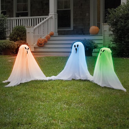 haunting ghost yard decor in fabrics with sparkling light inside