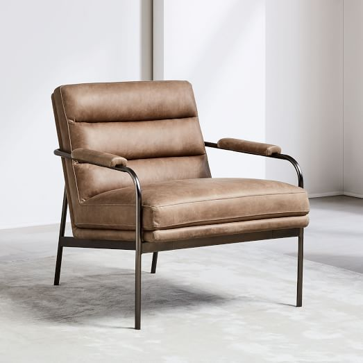 industrial style armchair by West Elm supported with fog burnished metal frame and shabby leather upholstery