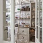 Large Pantry With Retro Touch In White Sliding Wood Ladder Open Shelves In White Light Wood Floors