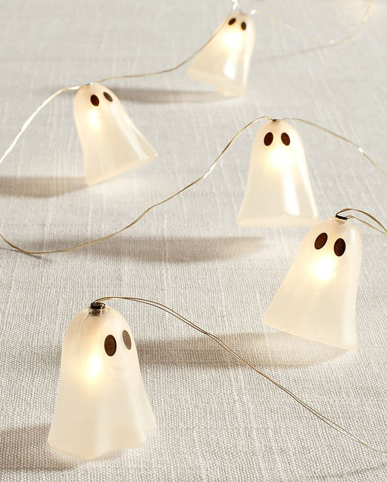 little cute ghost string lights in white with innocent black eyes