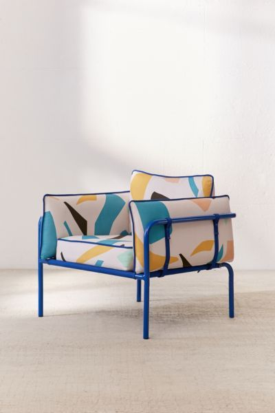 low profile design armchair by Urban Outfitters with geo prints and piping structure