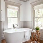 Minimalist Bathroom Huge Bathtub In White Wood Floors Modern Pattern Rug Decorative Bamboo Stool Glass Windows With Semi Transparent Shades