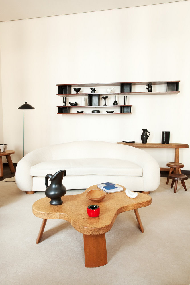 minimalist living room in white unique sofa in white unique coffee table made of wood minimalist floating shelves in black