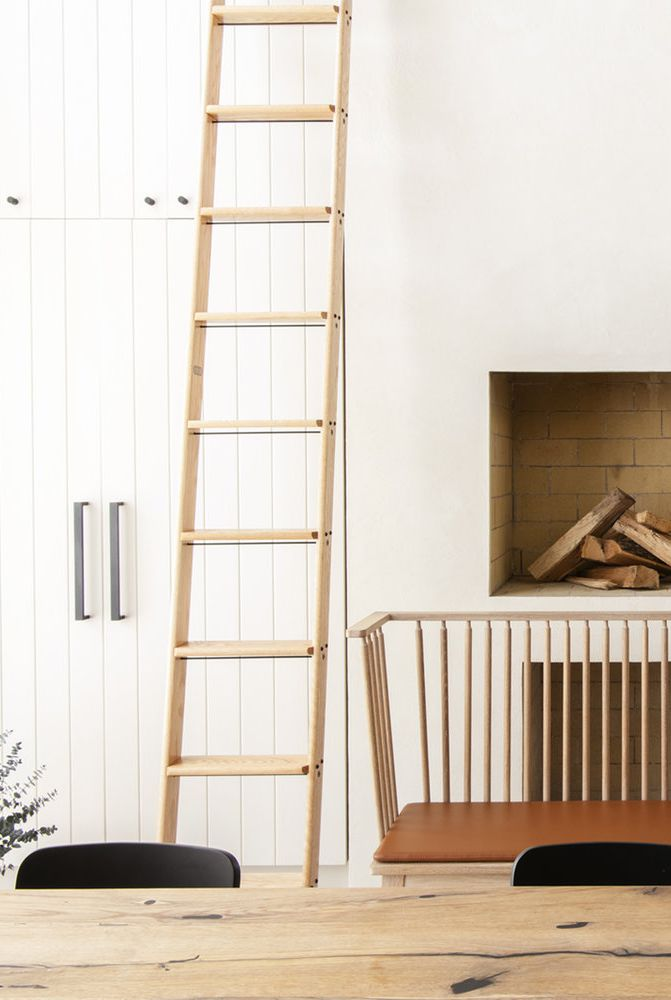 minimalist storage solution with metal hardware wood ladder minimalist fireplace