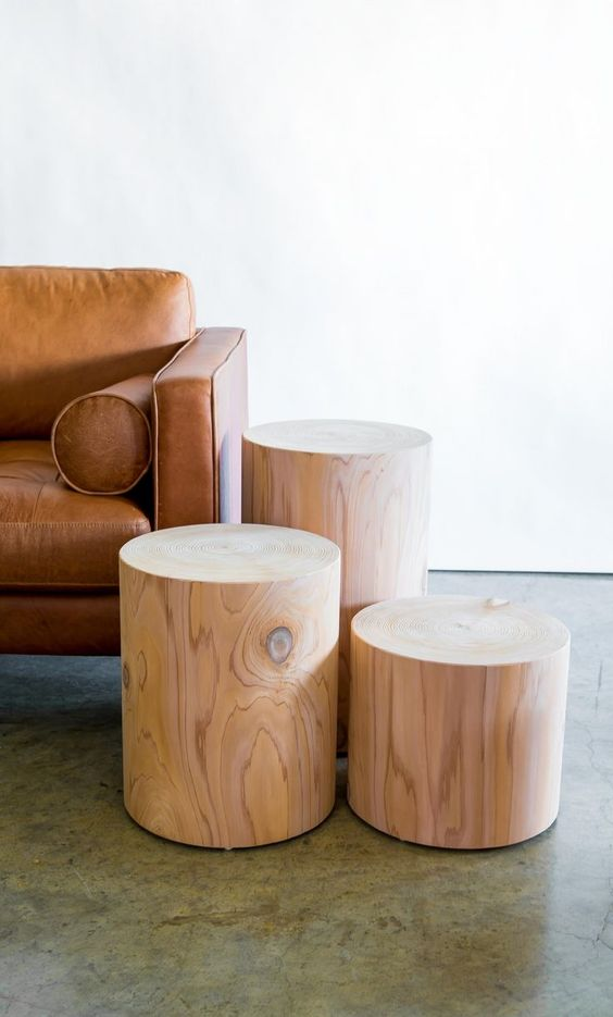 minimalist wood stools in different size and height leather sofa with armrests