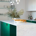 Modern Green White Kitchen Idea Wall Mounted Glass Shelves Modern Bulb Pendants Flat Surface Cabinetry White Marble Kitchen Island