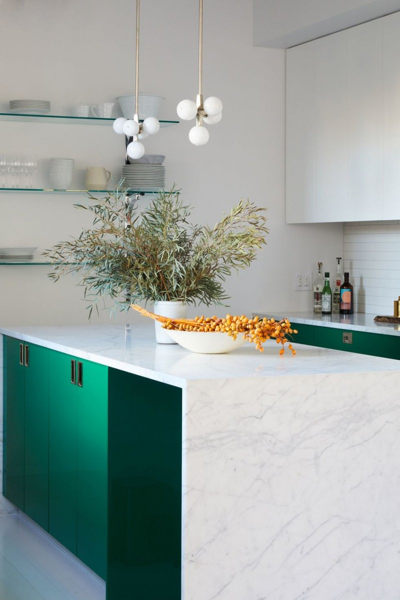 modern green white kitchen idea wall mounted glass shelves modern bulb pendants flat surface cabinetry white marble kitchen island