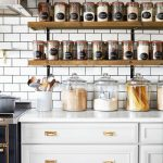 Open Shelves For Jars And Large Bowls White Kitchen Cabinetry With Brass Hardware Ceramic Subway Tile Walls