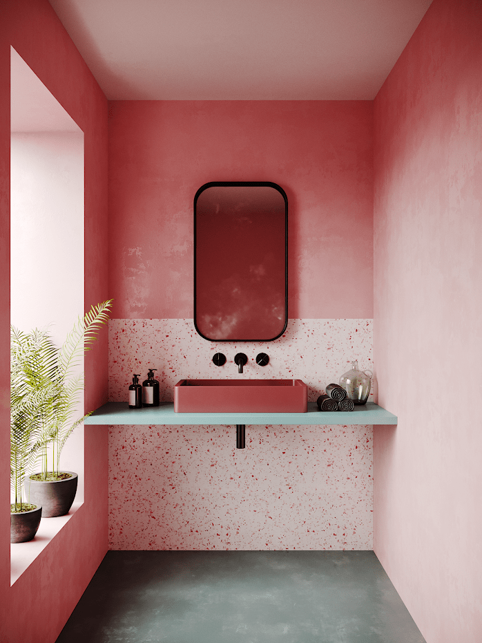 pink blush walls accented with grain like accents in low part of walls black frame wall mirror concrete floors