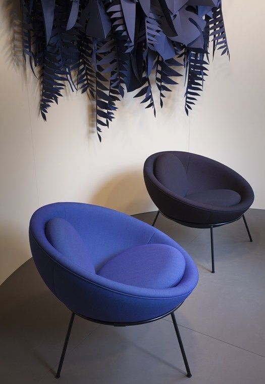 playful egg chairs in blue and black with tiny legs