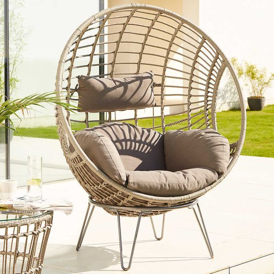 rattan egg chair with grey cushion and hairpin legs