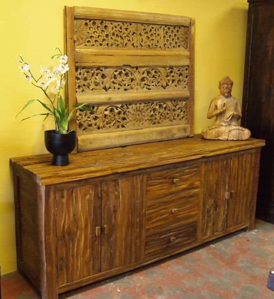 rustic buffet with Indonesian carved panel decoration and Budha