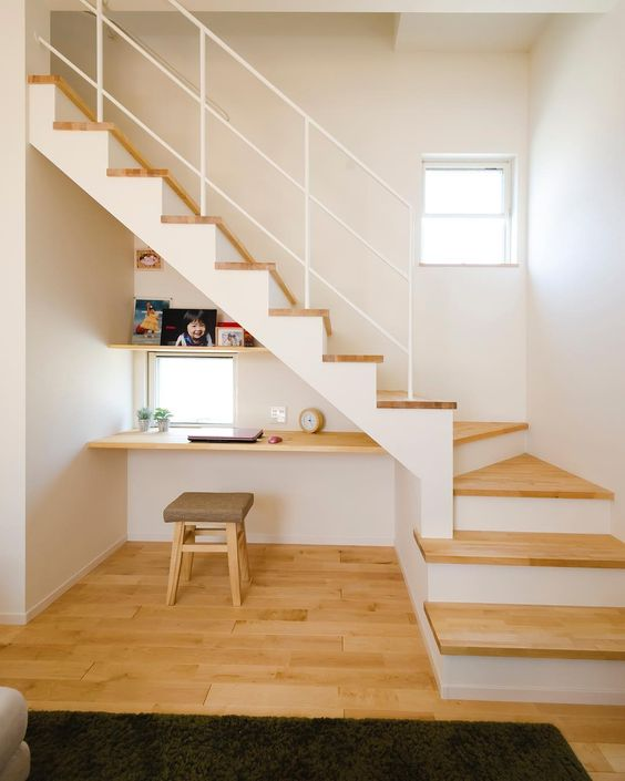 small minimalist floating wood working desk low profile stool small glass window minimalist interior stairs with white railing system light wood floors