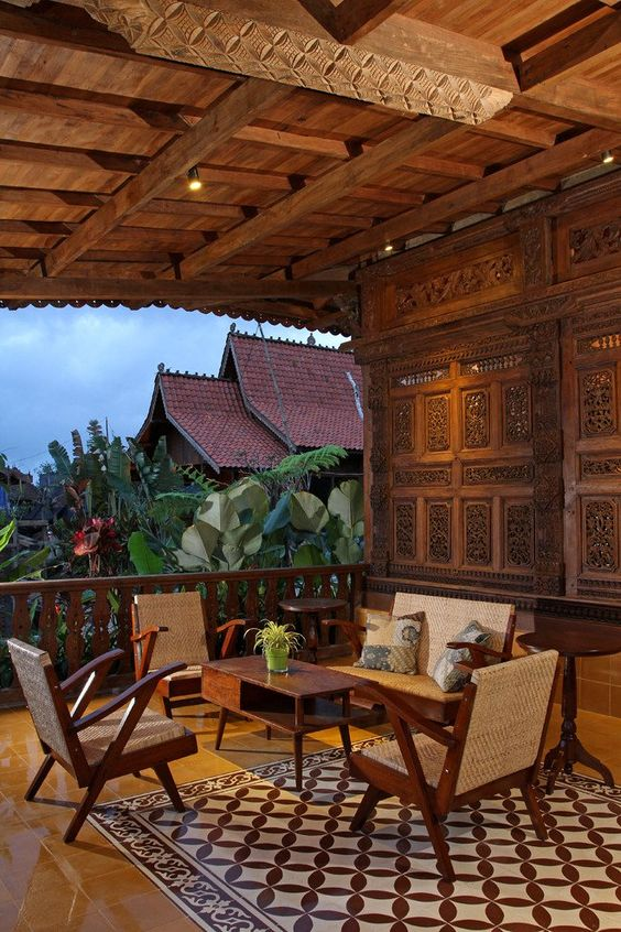 tropical style balcony wicker chairs from Indonesia Batik area rug wood carved wall panel from Indonesia exposed wood beams wood railing system