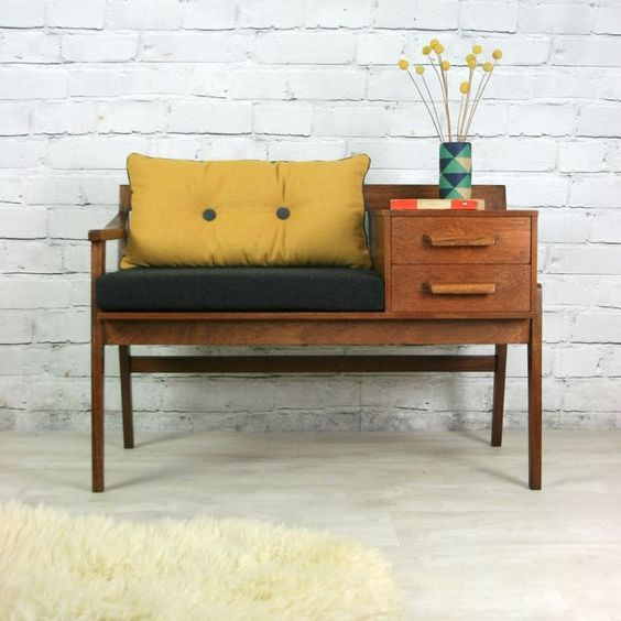 vintage and practical bench seat with integrated drawer system and table