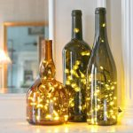 Wine Bottle Centerpieces Idea With Bulbs Of Christmas Lights