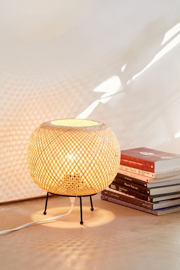 Alina rattan desk lamp with iron tripod base and globe rattan lampshade