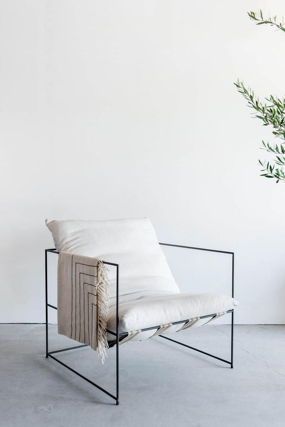 Sierra Chair with thin steel frame in black and crisp white cushions