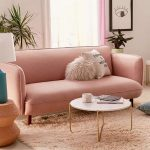Baby Pink Cushioned Sofa White Round Top Coffee Table With Brass Legs Baby Pink Fur Area Rug