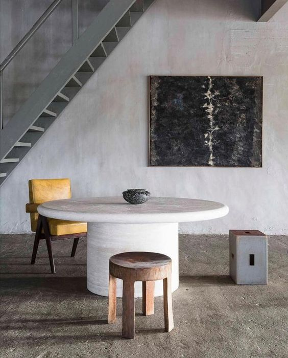 bare and worn concrete walls and floors contemporary furnishing pieces