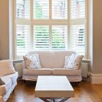 Bay Window With Trim Shutter In White White Sofa Slipcovers X Base Coffee Table In White Wood Plank Floors