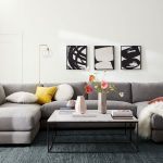 Black White Print On Canvas Wall Decor Gray Sofa With Throw Pillows White Top Coffee Table Dark Area Rug White Wall Paint Modern Floor Lamp With Glass Orb