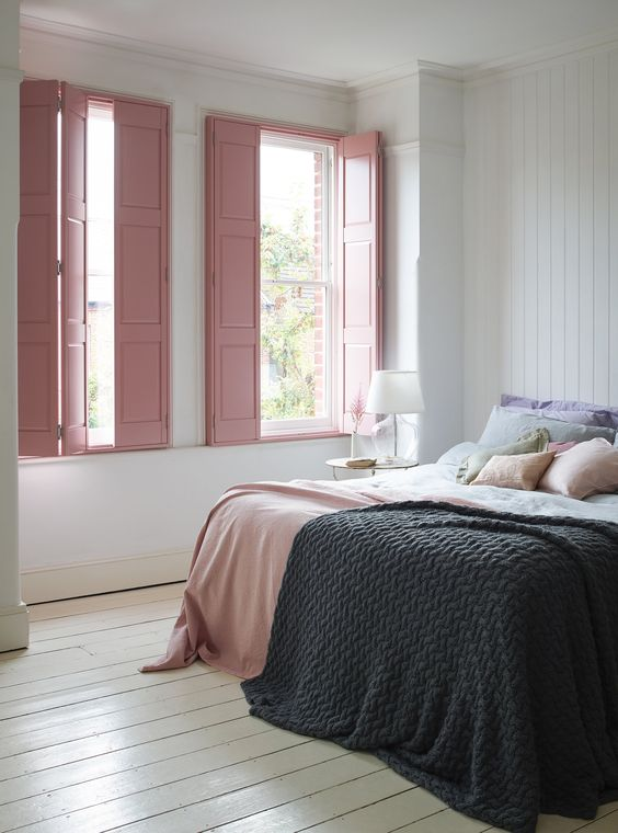 blush pink wood panel window shutters crisp white wood plank walls and floors