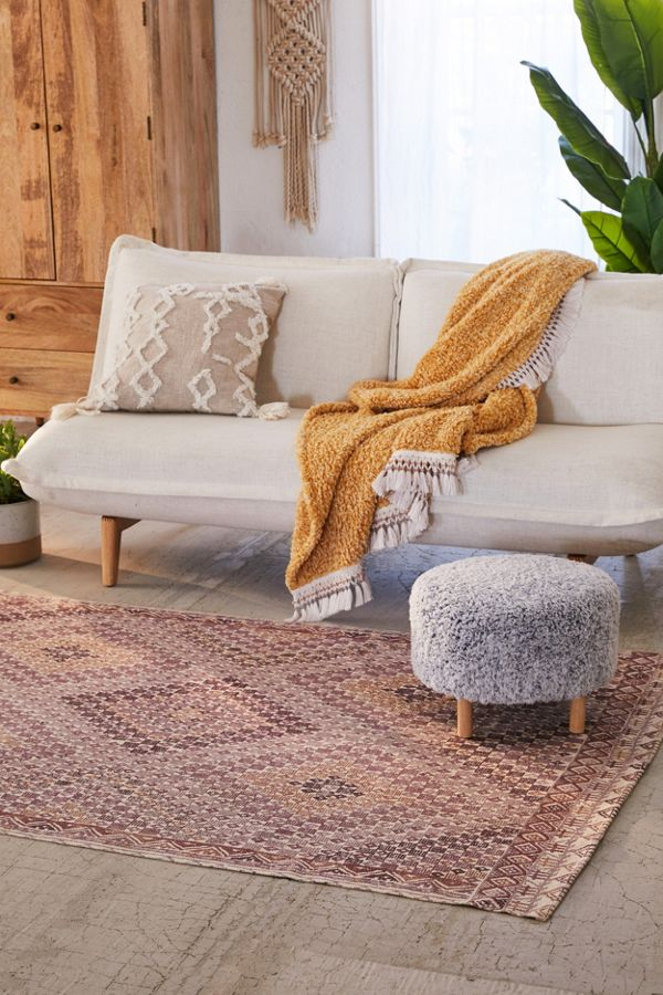 diamond cut patterned area rug with bordered edges midcentury modern sofa midcentury modern stool