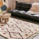 Ivory Area Rug With Diamond Cut Prints In Terracotta Tone Tassel Trims In Two Rug's Bottom Sides