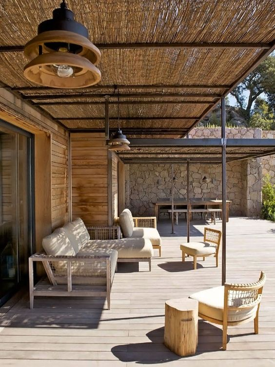 large size front porch with seating area outdoor dining space and dried seagrass cover on roofs