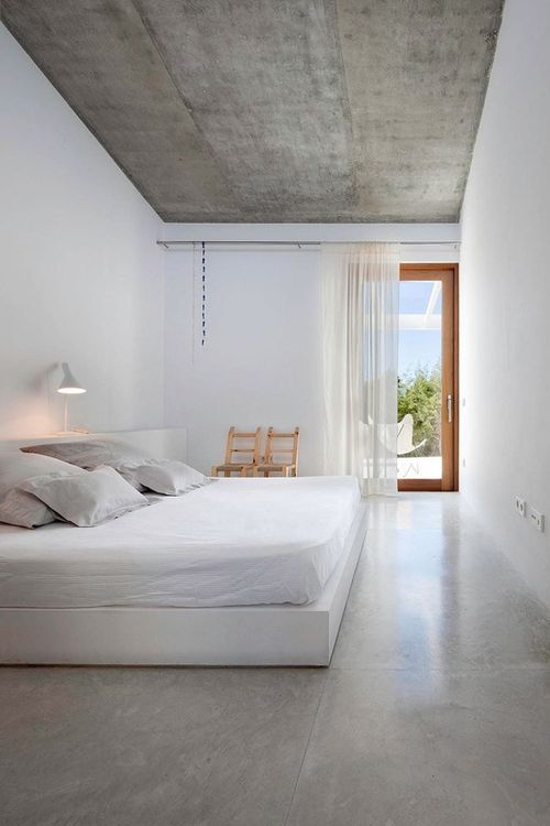 minimalist bedroom idea all white walls and floors white bedding treatment glass door with wood frame concrete finish ceiling