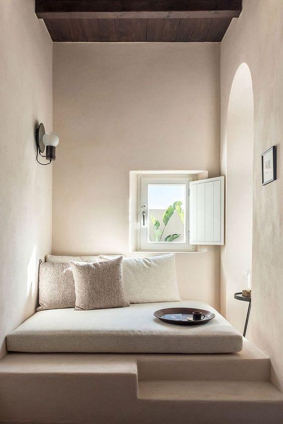 minimalist floor cushion in white white floor pillows white floors white walls small window