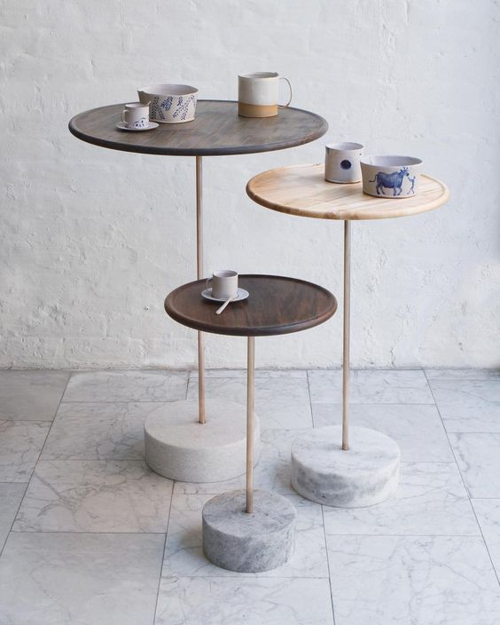 round top coffee tables with natural wood surface and solid concrete bases