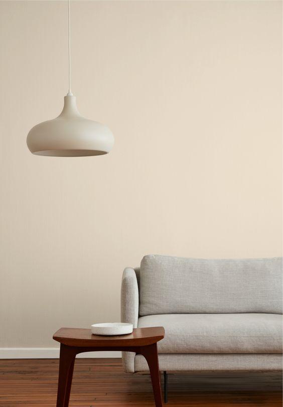 sandy beige wall idea modern white sofa dark wood side table modern white pendant