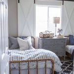 Sliding Barn Door As Window Shutters In White Classic Style Wood Bed Frame With Headboard Geometric Patterned Rug In Navy Blue Vintage Style Dresser