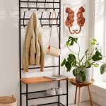 Small Entryway For Apartment Hook Solution Integrated With Bench Seat And Under Shoes Rack Small Carpet Potted Greenery