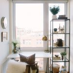 Small Home Office For Apartment Simple White Working Desk Working Chair Throw Fluffy Fur Blanket Modern Industrial Rack For Display Large Glass Window