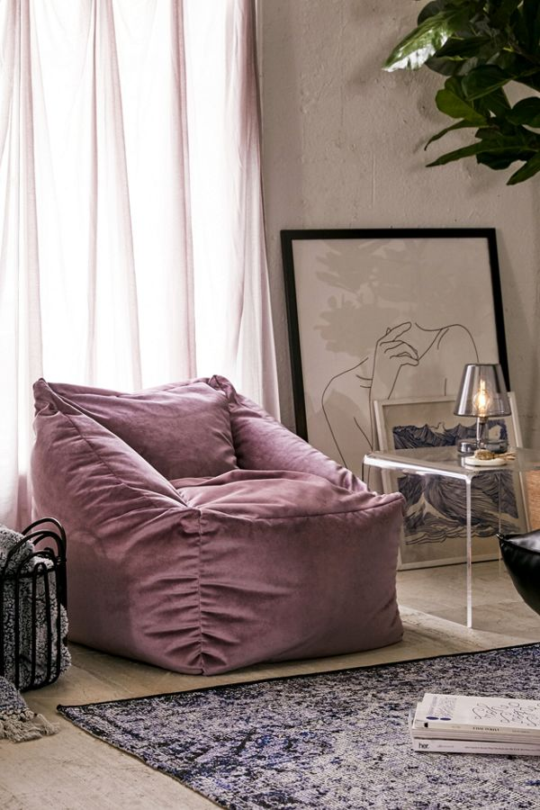 stylish velvet lounge chair in purple vintage style area rug