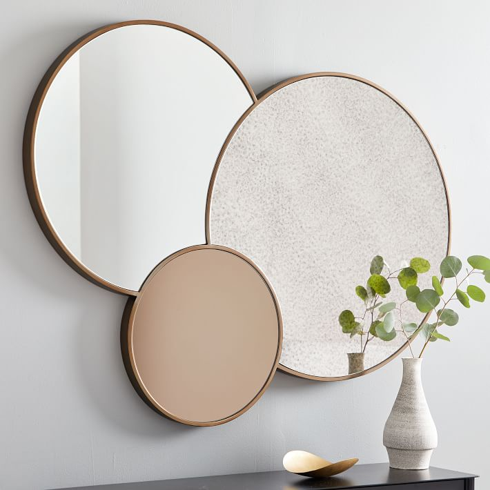 trio wall mirror with different layers of tint