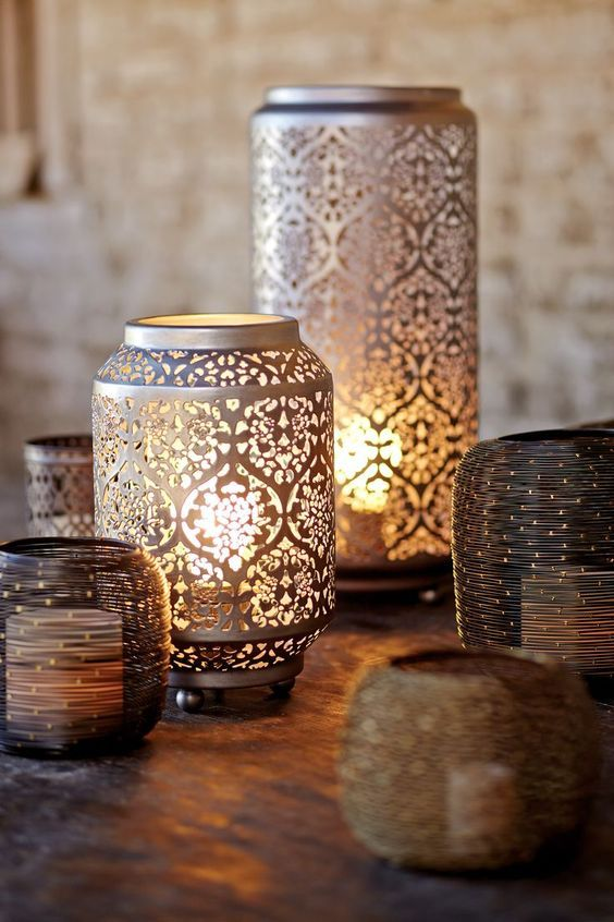 Moroccan candle holders made of solid sheet of brass cover with Moroccan motifs
