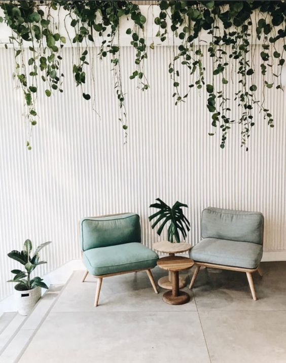 Scandinavian living room midcentury modern chair with light blue upholstery minimalist jungle decorating idea