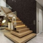 Black Finish Brick Wall With Wall Oclock Contemporary Style Wood Staircase With Clear Glass Railing System