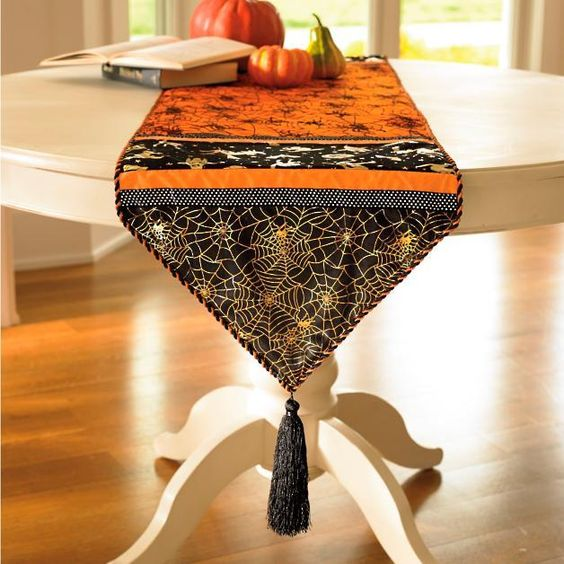 black orange Halloween table runner with pointed edge plus tassel